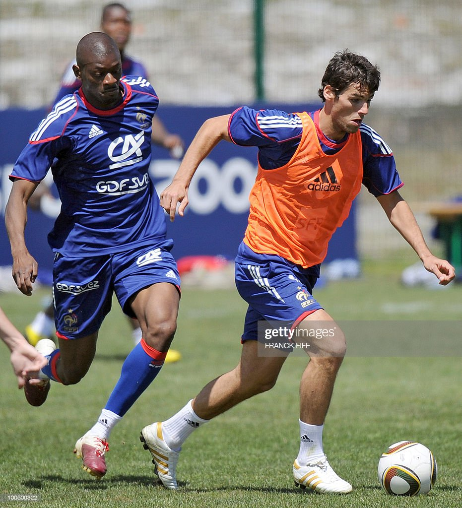 French national football team's midfielder Yoann Gourcuff (R) vies with his teammate, defender Abou Diaby during a training session, on May 25, 2010, near Tignes in the French Alps, as part of the preparation for the upcoming World Cup 2010. France will play against Uruguay in Capetown in its group A opener match on June 11.