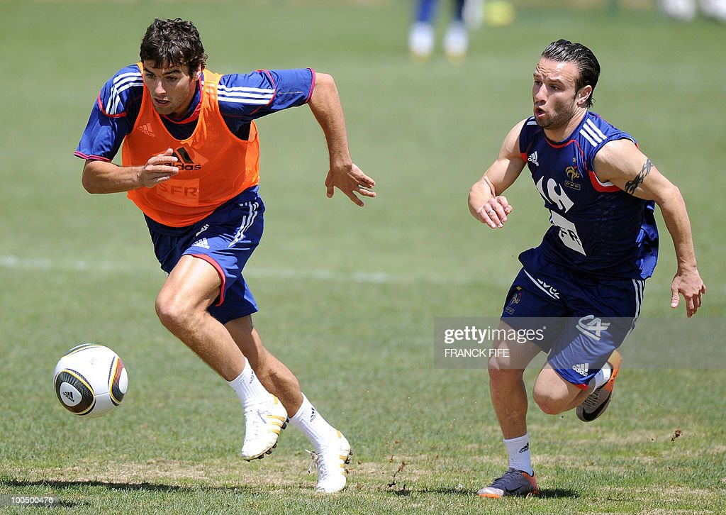 French national football team's midfiielder Yoann Gourcuff (L) vies with teammate Mathieu Vabuena (R) during a training session, on May 25, 2010, near Tignes in the French Alps, as part of the preparation for the upcoming World Cup 2010. France will play against Uruguay in Capetown in its group A opener match on June 11.