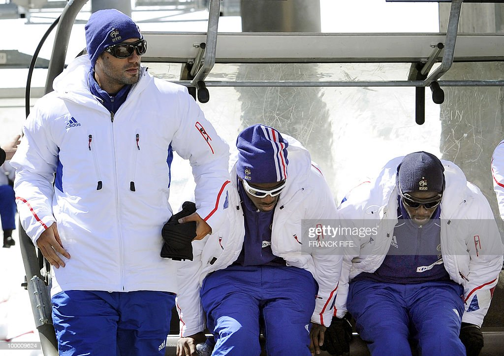 French national football team's player Marc Planus (L) and teammates leave a ski lift upon their arrival in Tignes, French Alps, on May 20, 2010 after having spent the night with teammates at the top of the Tignes glacier, as part of their altitude training in preparation for the 2010 World cup in South Africa.