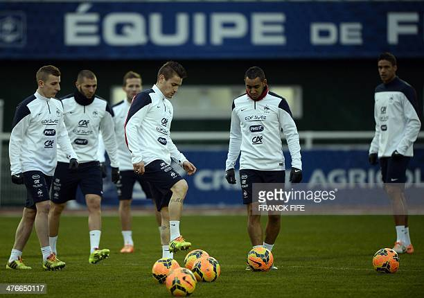 French national football team's players Mathieu Debuchy and Dimitri Payet take part in a training session in ClairefontaineenYvelines outside Paris...