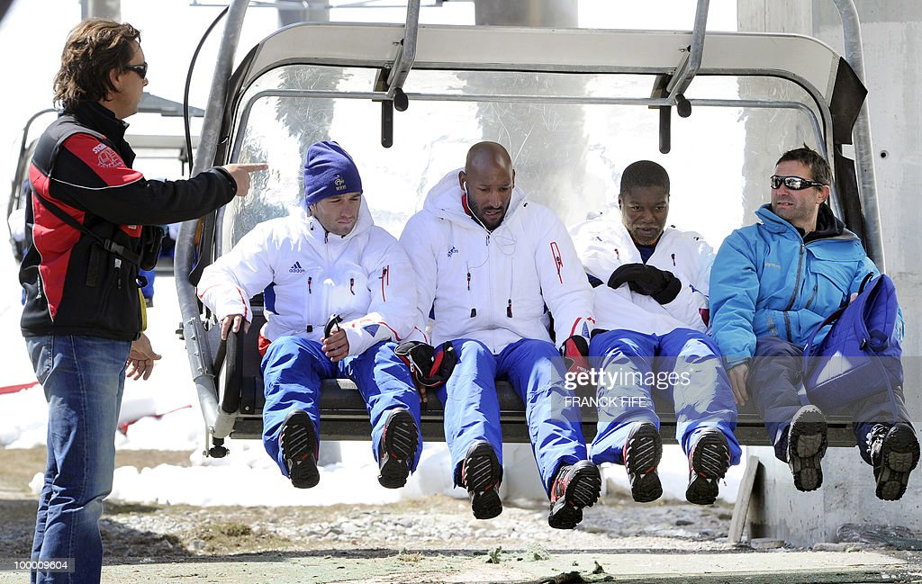 French national football team's players Mathieu Valbuena, Nicolas Anelka and Djibril Cisse sit on a ski lift upon their arrival in Tignes, French Alps, on May 20, 2010 after having spent the night with teammates at the top of the Tignes glacier, as part of their altitude training in preparation for the 2010 World cup in South Africa.