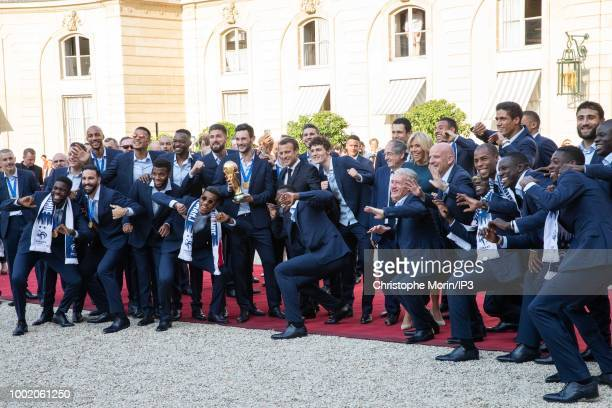 French national football team's players pose with French President Emmanuel Macron and French President Emmanuel Macron's wife Brigitte Macron before...