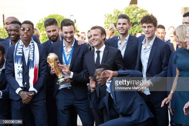 French national football team's players pose with French President Emmanuel Macron before a reception at the Elysee Presidential Palace on July 16...