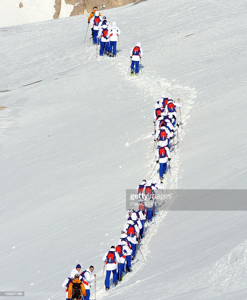 French national football team's players walk with snowshoes at the top of the Tignes glacier on May 19, 2010 in the French Alps. The French national team should sleep in altitude tonight and climb up the glacier on May 20, if weather permitting, as part of their altitude training in preparation for the 2010 World cup in South Africa.