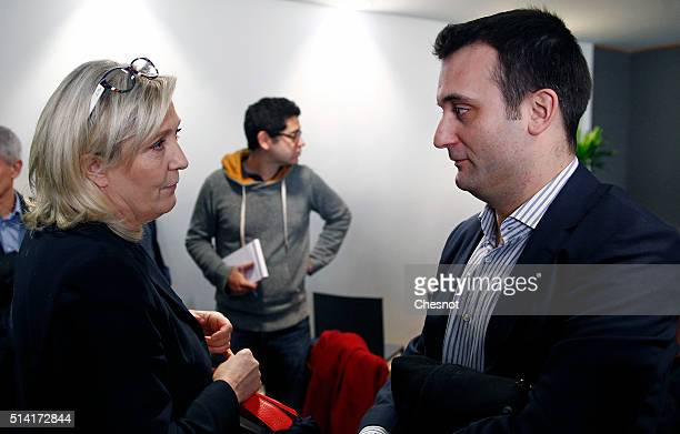 French National Front farright party Marine Le Pen President talks with French far right Front National party's vicepresident Florian Philippot after...