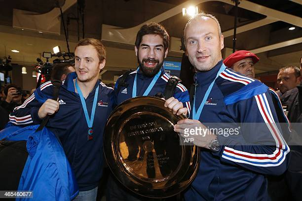French national handball team players Valentin Porte Nikola Karabatic and Thierry Omeyer pose with the European championship trophy on January 27...