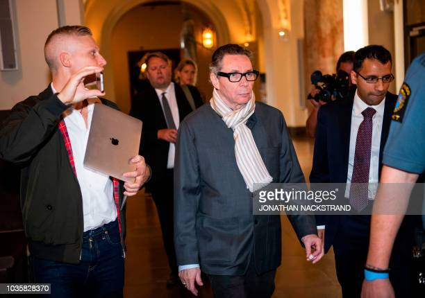 French national JeanClaude Arnault arrives at the district court in Stockholm on September 19 where is to appear accused of rape and sexual assault...