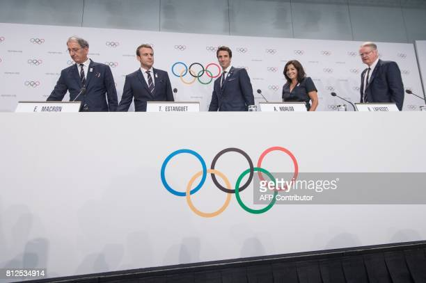 French National Olympic Committee President Denis Masseglia French President Emmanuel Macron Paris 2024 Olympic bid copresident Tony Estanguet Mayor...