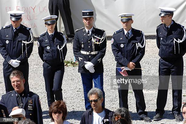 French national police officers stand at attention during commemoration ceremonies September 11 2006 in New York City Today marks the fifth...