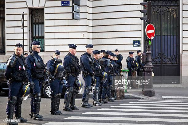 French National Police protect a road crossing during union strikes