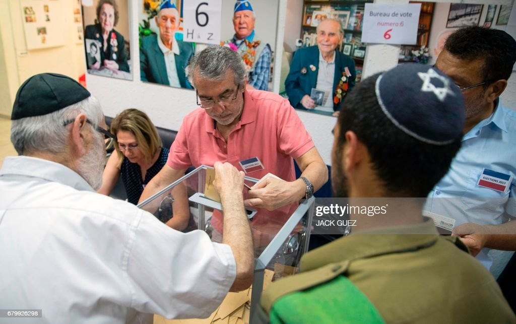 A french national residing in israel casts his vote during the
