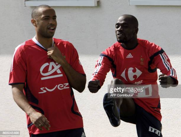 French national soccer stars Thierry Henry and teammate Claude Makelele warmup during a training session 21 August 2007 in Senec ahead of a friendly...
