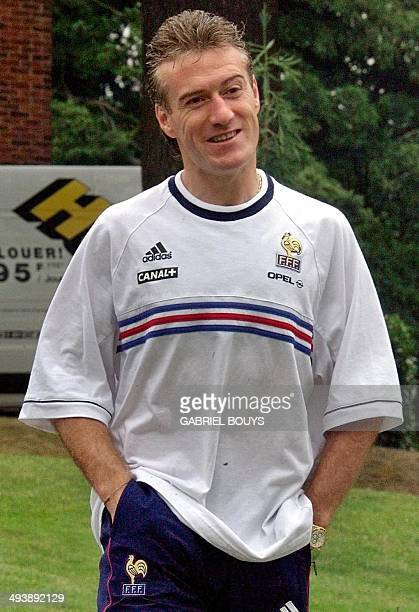 French national soccer team captain Didier Deschamps smiles as he arrives 07 July for a press conference in Clairefontaine near Paris France will...