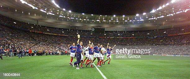 French national soccer team players celebrate on the pitch 12 July at the Stade de France in SaintDenis near Paris after France defeated Brazil in...