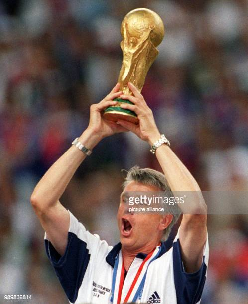 French national team coach Aime Jacquet jubilantly hoists the FIFA World Cup after the 1998 World Cup final France against Brazil at the Stade de...