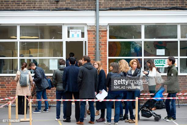 French nationals queue up outside the Lycee Francais Charles de Gaulle in London on April 23 as voting begins in the first round of the 2017 French...