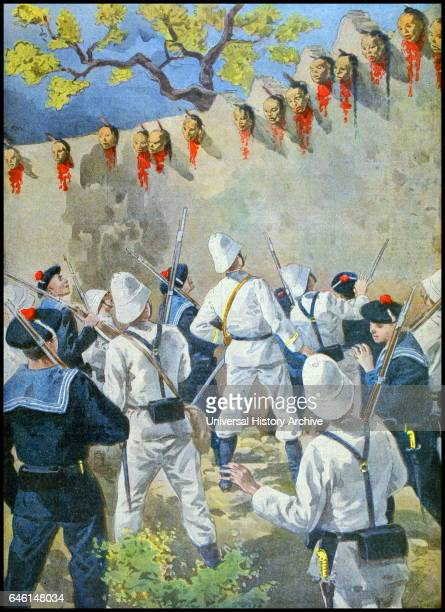 French naval and marine forces look at heads of executed Boxer rebels on the walls of Chaozhou a city in the eastern Guangdong province of the China...