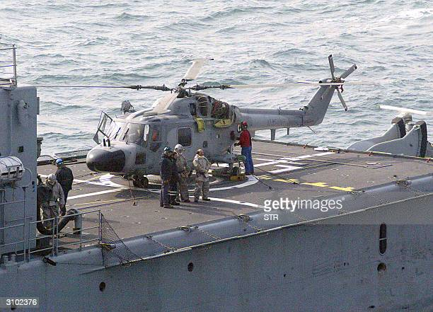 French naval helicopter on the deck of a Chinese warship the first landing of a foreign military aircraft on a Chinese naval vessel during a joint...