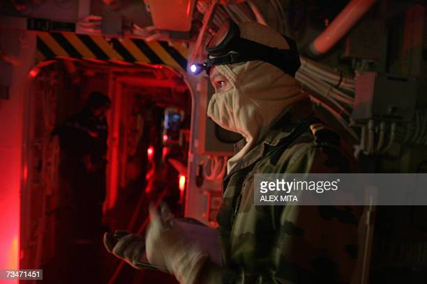 French Navy officer directs a fire drill aboard the stealth ship Surcouf 16 February 2007 The 150 sailors on board the frigate called the Surcouf who...