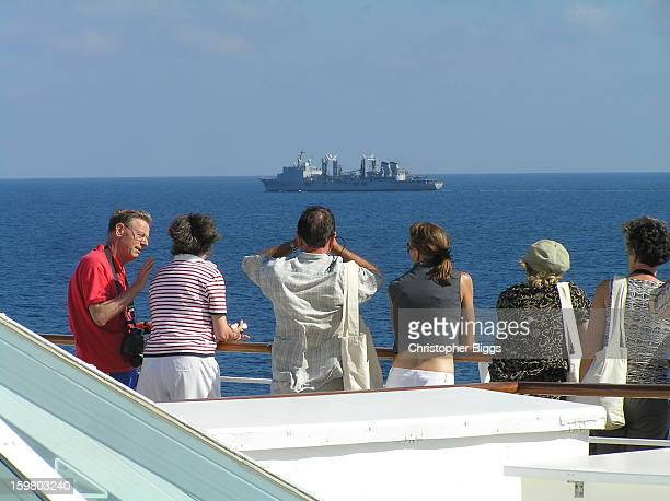 French Navy supply ship travelling along side with personnel who established a substantial presence on board the the luxury cruise ship Seabourn...