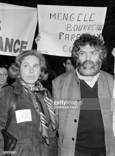 French nazi hunter Beate Klarsfeld and writer Marek Halter demonstrate on February 27 1985 to demand the extradition of nazi Dr Josef Mengele known...