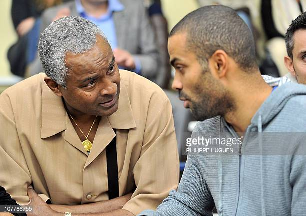 French NBA player Tony Parker speaks with his father before attending the French basketball match BC Orchies vs Get Vosges on September 25 2010 in...