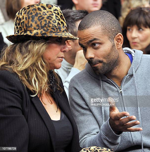 French NBA player Tony Parker speaks with his mother Pamela Firestone before attending the French basketball match BC Orchies vs Get Vosges on...