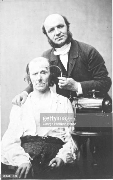 French neurologist Dr Guillaume Benjamin Amand Duchenne demonstrates the control of facial muscles with the use of electrical current on an...