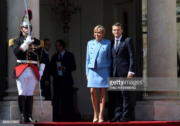 French newly elected President Emmanuel Macron poses with his wife Brigitte Trogneux at the Elysee presidential Palace after the handover and prior...