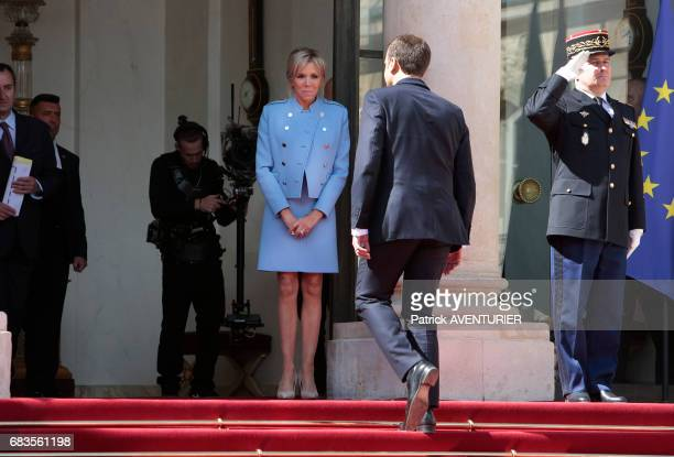 French newly elected President Emmanuel Macron poses with his wife Brigitte Macron at the Elysée presidential Palace after the handover ceremony with...