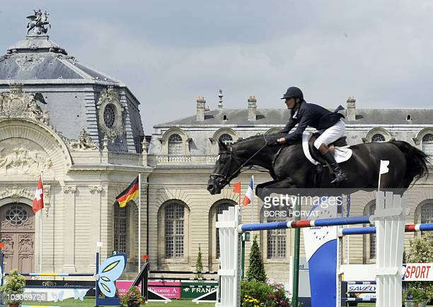 French Nicolas Delmotte jumps an obstacle on Luccianno during the International Chantilly Show Jumping as part of the Global Champion Tour in...