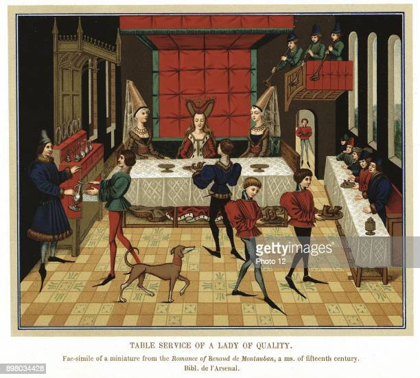 French noblewoman dining with members of her household, waited on by servants and Butler wearing tunic, hose, and long pointed shoes. Trumpeters play...