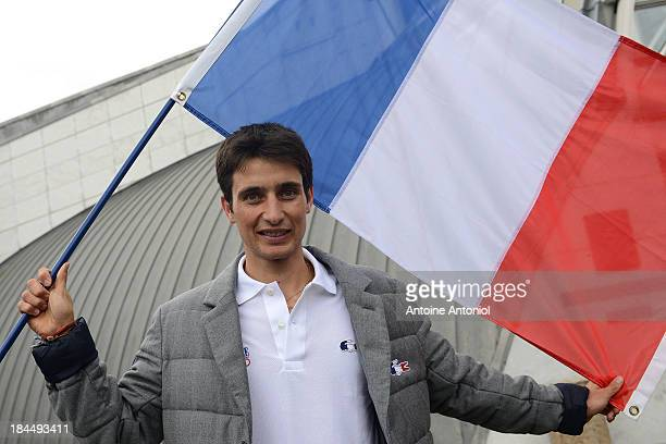 French nordic combined ski champion Jason Lamy Chappuis poses with his national flag after being chosen as his countries flag bearer for the Sochi...