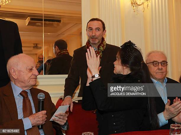 French novelist Alain Blottiere receives from French businessman Pierre Berge and Belgian writer Amelie Nothomb the Prix Decembre literary prize for...