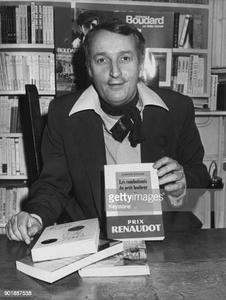 French novelist Alphonse Boudard with his book 'Les Combattants du petit bonheur' for which he was awarded the Prix Renaudot 22nd November 1977
