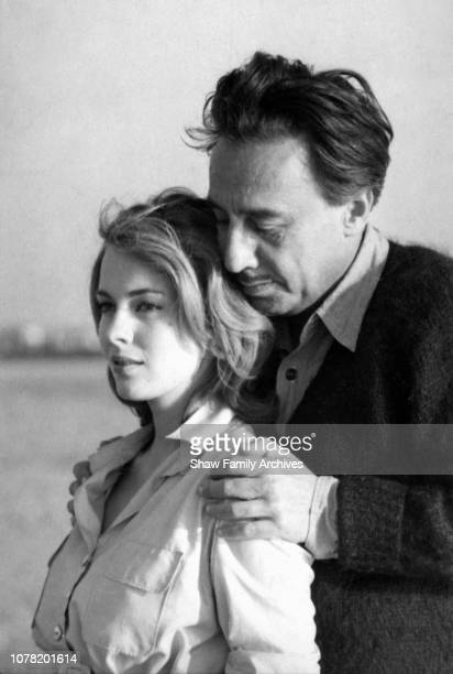 French novelist, diplomat, film director, and World War II aviator Romain Gary with his wife, the American actress Jean Seberg, on a beach in 1961,...
