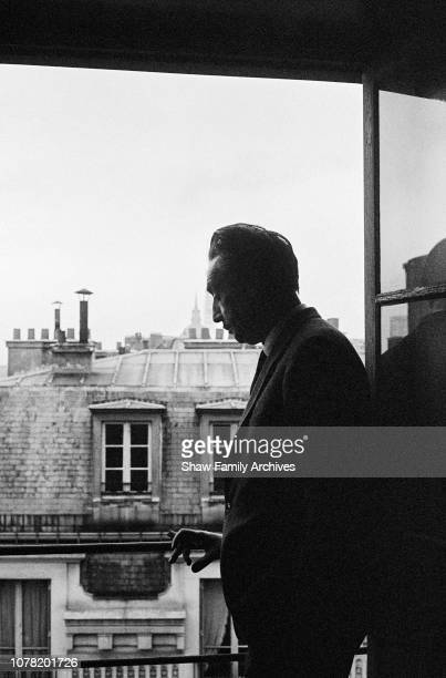 French novelist, diplomat, film director, and World War II aviator Romain Gary at a cafe in 1961, Rome, Italy.