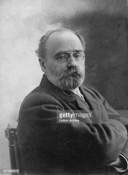 French novelist Emile Zola poses for Gerschel with his arms folded circa 1900