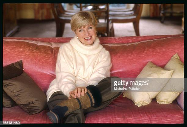 French novelist Francoise Dorin poses on her Paris home couch on the occasion of the release of her latest book Nini patte en l'air published by...