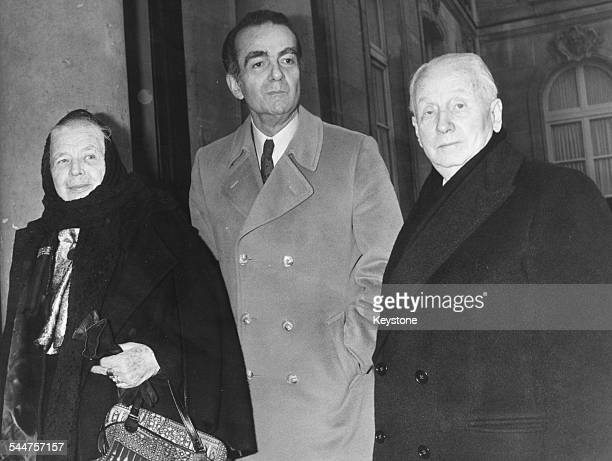 French novelist Marguerite Yourcenar with author Michel Driot and the Duke de Gastries Director of the Academic Institute of France on the steps of...