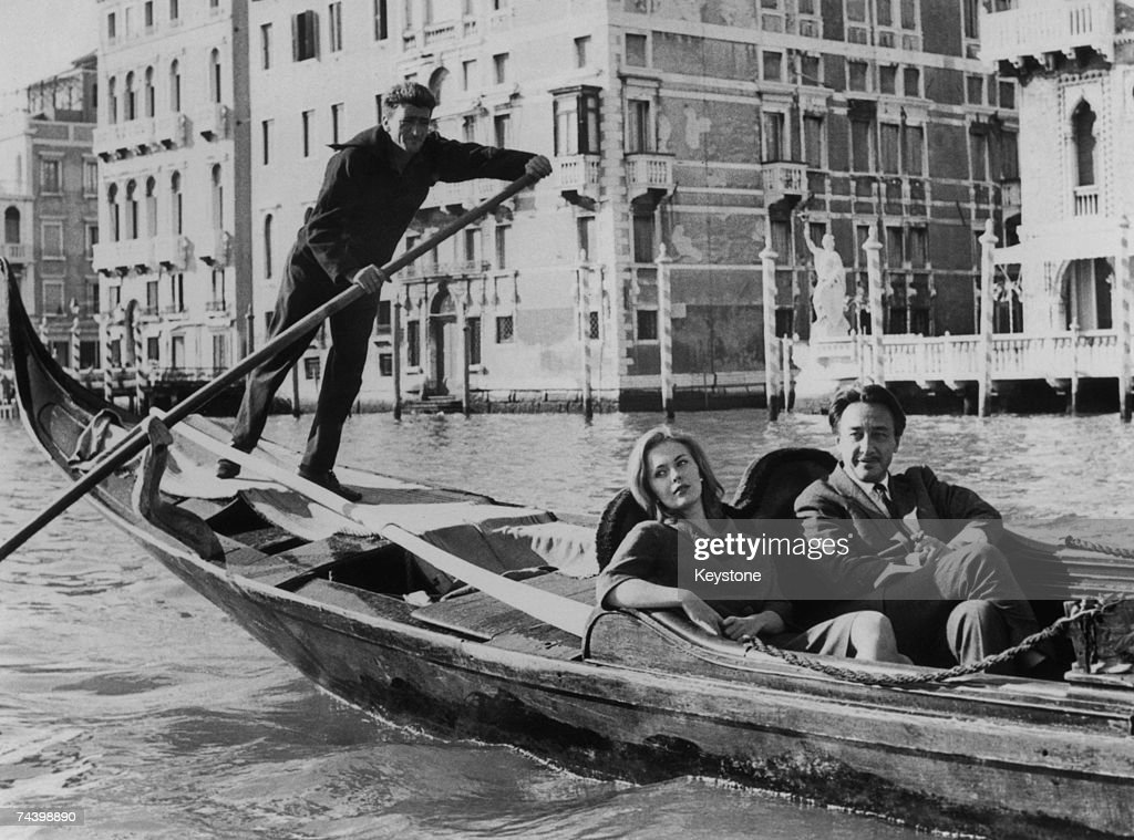 French novelist, screenwriter, film director and diplomat Romain Gary (1914 - 1980) holidays in Venice with his fiancee, American actress Jean Seberg (1938 - 1979) 27th October 1961.