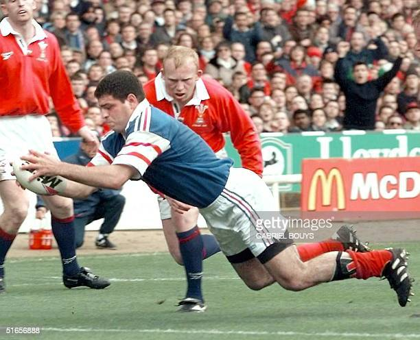 French number eight Marc Lievremont scores his team's first try versus Wales 05 April during the final match of the Five Nations tournament at...
