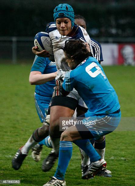 French number eight Safi N'Diaye vies with two Italian players during the Women's Six Nations rugby union match France vs Italy at the Stade Ernest...