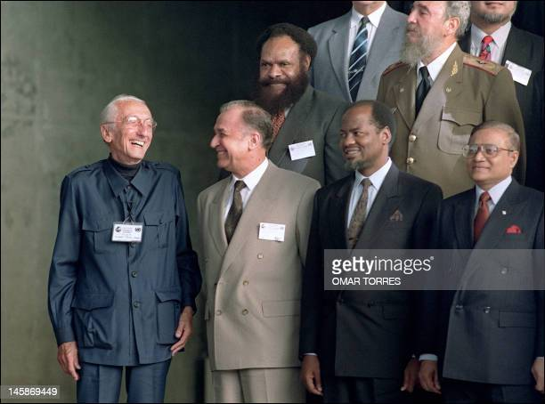French oceanographer Jacques Cousteau laughs 13 June 1992 during a group photo of world leaders attending the Earth Summit in Rio de Janeiro AFP...