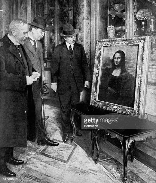 A French official examines the restored Mona Lisa at the Uffizi Gallery