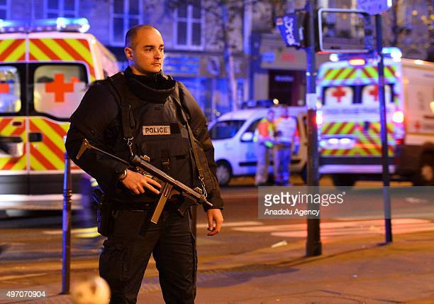 French officials and medics work near Le Petit Cambodge restaurant in the 11th district after a driveby shooting killing 11 people November 14 Paris...