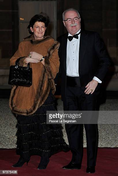 French oil giant Total chief executive Christophe de Margerie arrives with his wife to attend a state dinner honouring visiting Russian President...