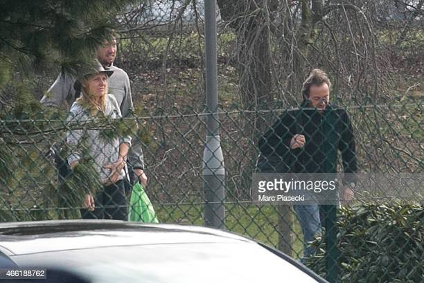 French Olympic champion swimmer Alain Bernard and frenchSwiss snowboarder AnneFlore Marxer arrive at Honours Pavilion at CharlesdeGaulle airport on...