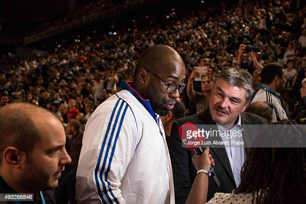 French Olympic Champion Teddy Riner and David Douillet talk with a journalist during the Paris Grand Slam 2015 at the Palais Omnisports de ParisBercy...