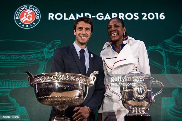 French olympic champions Tony Estanguet and MarieJose Perec pose next to the tropies of the RolandGarros tennis tournament prior to take part in the...
